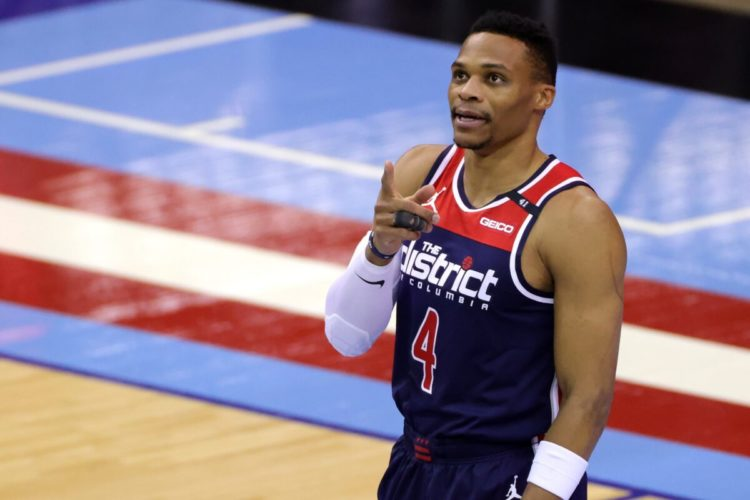 Jan 26, 2021; Houston, Texas, USA; Washington Wizards guard Russell Westbrook (4) gestures to fans during the first quarter of a game against the Houston Rockets at Toyota Center. Mandatory Credit: Carmen Mandato/Pool Photo-USA TODAY Sports